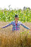 Young woman standing in a wheat field Stock Photos