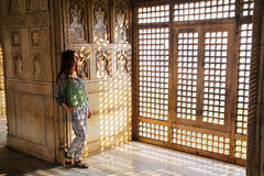 Young woman standing by the window in Khas Mahal, Agra Fort, Utt Stock Photos