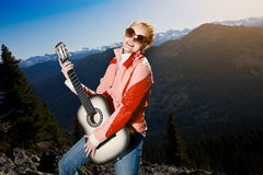 Free Young Woman Standing With Guitar Royalty Free Stock Photography - 21544907