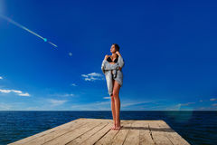 Young woman standing on wooden pier Stock Photography