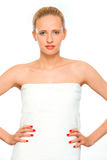 Young woman standing wrapped in white towel Royalty Free Stock Photography