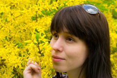The young woman standing at a yellow tree. Dreaming Stock Images