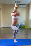 Young woman standing in yoga asana Royalty Free Stock Photo