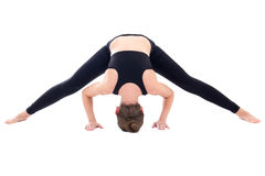 Young woman standing in yoga pose isolated on white Royalty Free Stock Photography