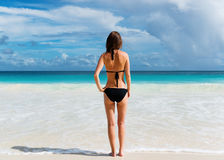 Young woman stands on the beach Royalty Free Stock Image