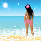 Young woman stands on the beach at sunset time Stock Photo