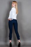 Young woman stands full length half turn. Fashionable young woman stands full length half turn Royalty Free Stock Photo