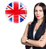 Young woman stands near bubble with Britain flag.