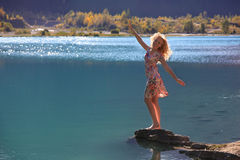 Young woman stands near the lake Royalty Free Stock Photography