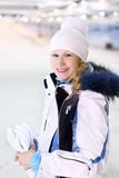 Young woman stands with skis Royalty Free Stock Images