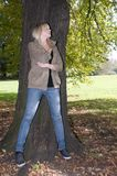 Young woman stands on a tree Royalty Free Stock Photos