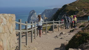 Young woman staring at the ocean in Cabo da Roca stock video footage