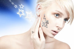 Young woman with stars Royalty Free Stock Images