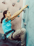 Young woman starting climbing Royalty Free Stock Image