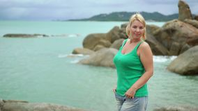 Young woman staying near sea. Young blonde woman staying near sea stock video footage