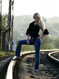 Young Woman Staying On Railway Royalty Free Stock Photos