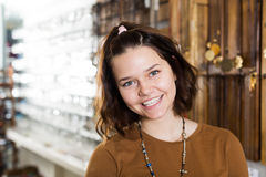 Young woman staying in the store. Portrait of cheerful young woman staying in the store of jewelry Stock Image
