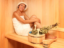 Young woman in a steam bath-room Royalty Free Stock Photos