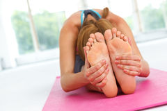 Young woman stetching after workout. Stock Photos