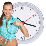 Young woman with stethoscope and clock Royalty Free Stock Photography