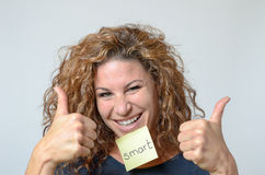 Young woman with a sticky note in her face Stock Photography
