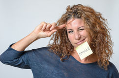 Young woman with a sticky note in her face Royalty Free Stock Images