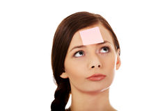 Young woman with sticky notes on forehead Royalty Free Stock Photo