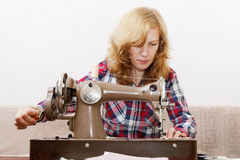 Young woman stitching fabric using a sewing machine Stock Photography