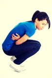 Young woman with stomach issues.  stock photo
