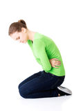 Young woman with stomach issues Stock Image