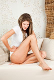 Young woman with stomachache. Young, beautiful woman with stomachache royalty free stock photo