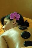 Young Woman and Stone Massage Royalty Free Stock Images