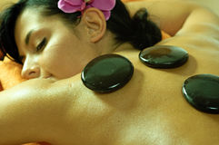 Young Woman and Stone Massage. Photo of young woman using stone massage royalty free stock image