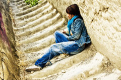 Young woman on stone stairs Stock Photography