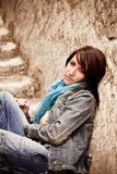 Young woman on stone stairs Royalty Free Stock Images