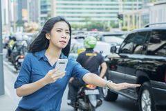 Young woman stopping online cab royalty free stock images