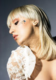 Young woman with strasses. Portrait of young woman with strasses on face Stock Photography