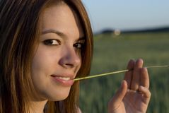 Young woman and straw Royalty Free Stock Photos