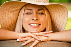 Young woman in straw hat Stock Photos