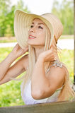 Young woman in straw hat. Cheerfully laughs Royalty Free Stock Photos