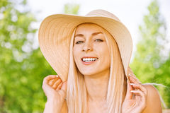 Young woman in straw hat Stock Photography