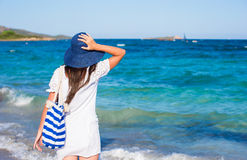 Young woman with straw hat and blue stripy bag at Royalty Free Stock Images