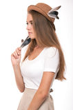 Young woman in straw hat with feathers. Blond girl studio shot. Royalty Free Stock Images