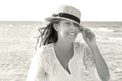 A young woman in a straw hat, fervently laughing against the bac Royalty Free Stock Image