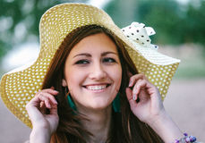 Young woman in straw hat smiling Stock Image