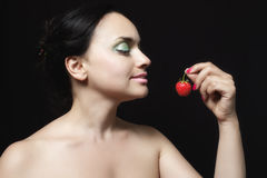 Young woman with strawberry Stock Photography