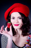 Young woman with strawberry Royalty Free Stock Images