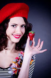 Young woman with strawberry Royalty Free Stock Photos
