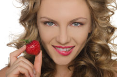 Young woman with strawberry in hands Royalty Free Stock Photos
