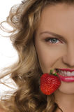 Young woman with strawberry teeth Royalty Free Stock Photos